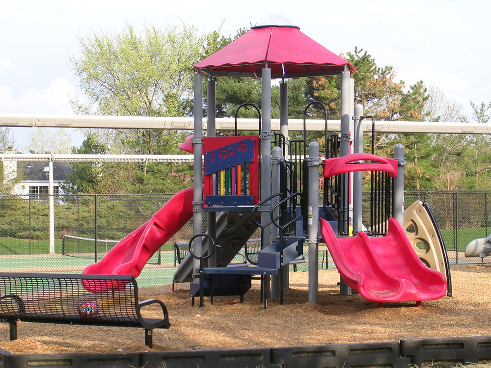 A separate play structure was designed for youngsters 2-5 years old so they would not be intimidated by older children.