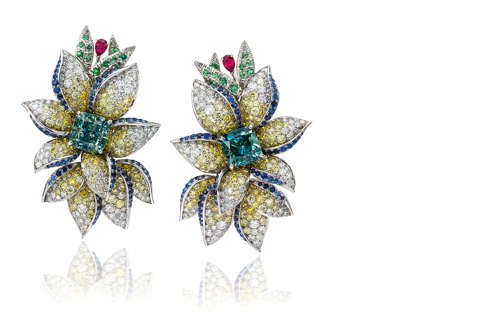 The Caribbean Earrings - A marvelous duo of natural Vivid Blue-Green diamonds set in a handcrafted one of a kind design inspired by the Caribbean.