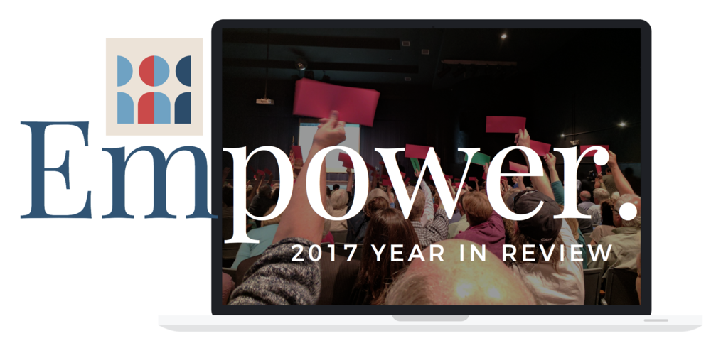 The word Empower written over a laptop with a picture of constituents a member of Congress' town hall holding up red pieces of paper.