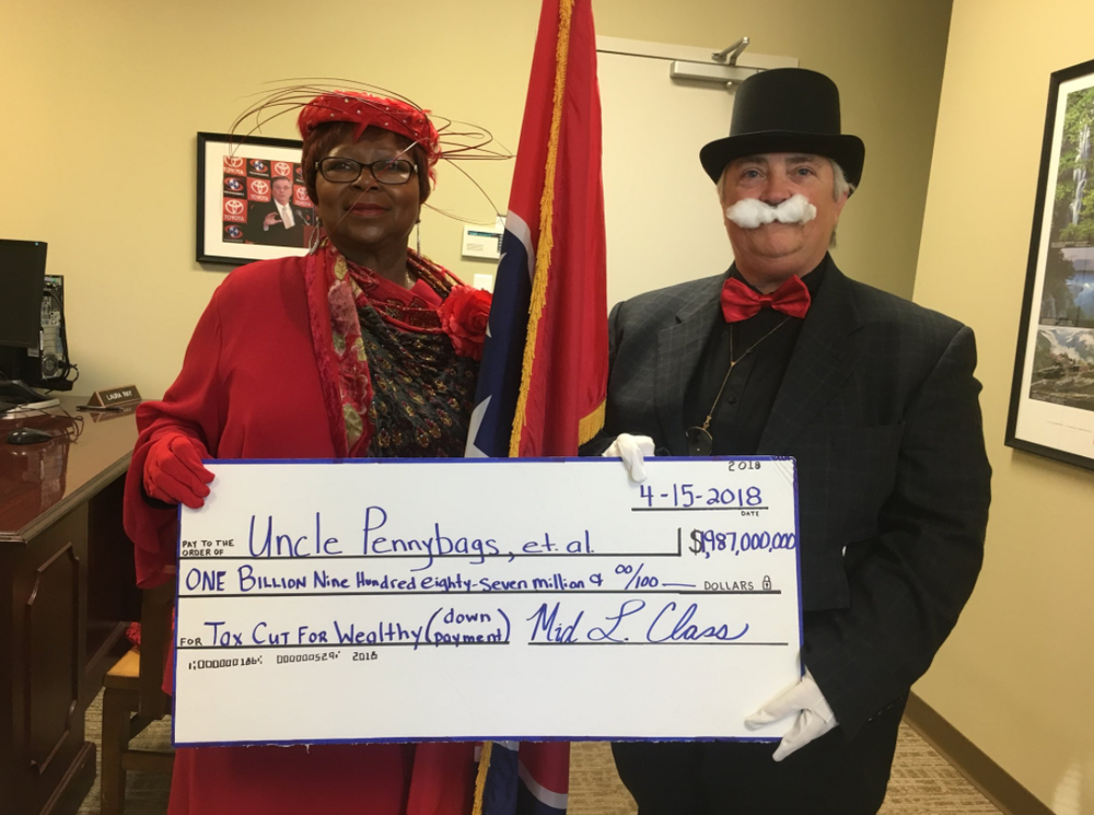 Indivisible Jackson gives their member of Congress an earful on the Tax Scam.