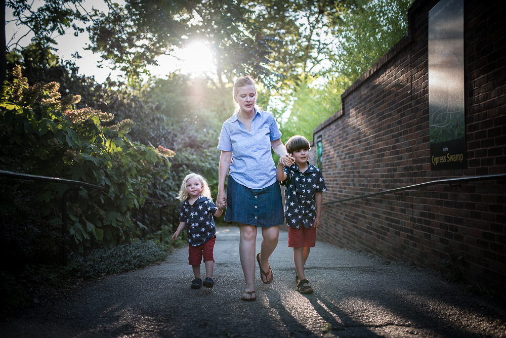 a mom and her sons walking through beautiful early evening light in St. Louis.jpg
