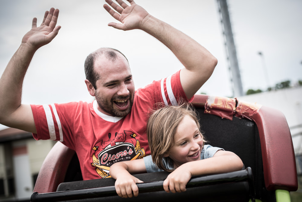 father and son enjoy little boy's first roller coaster at the fourth of july carnival in Webster Groves, MO.jpg