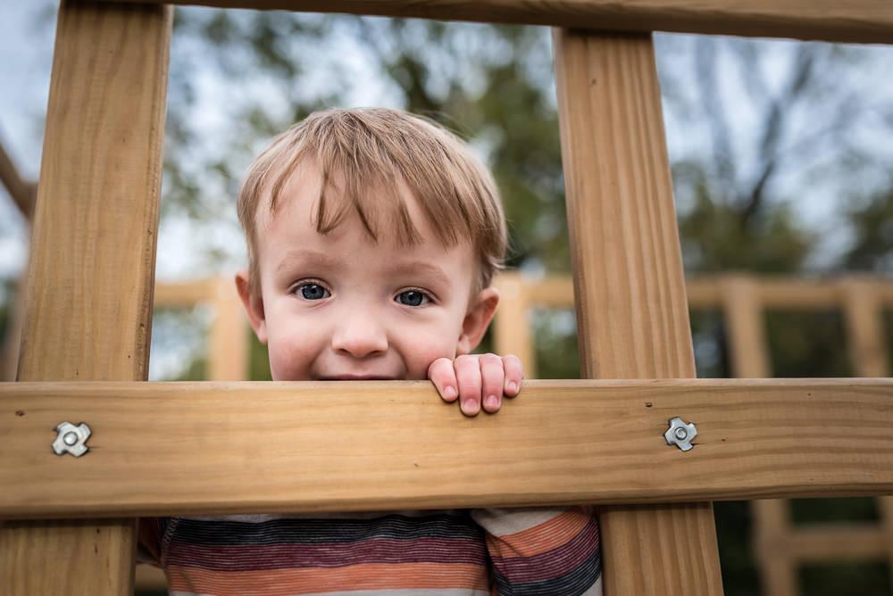 little boy on playground at the pumpkin patch.jpg