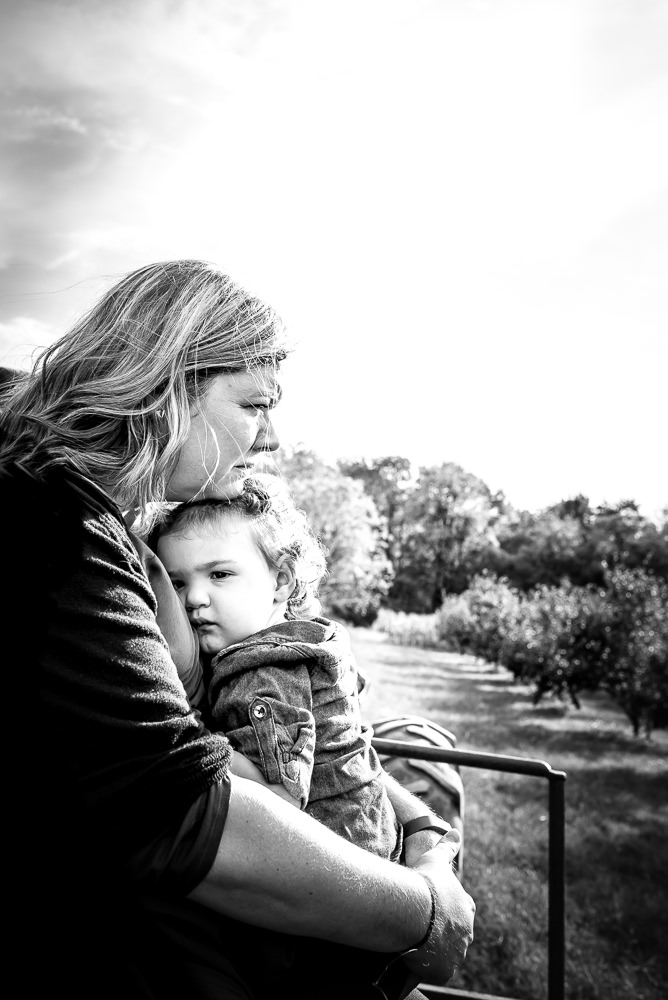 mom and daughter on a tractor ride during documentary family photo session.jpg