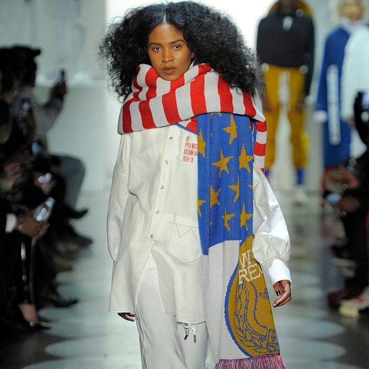 DESIGNER JEAN-RAYMOND USES HIS PLATFORM TO BRING ATTENTION TO PRESSING ISSUES SUCH AS POLICE BRUTALITY AND RACIAL INEQUITY. HIS UNAPOLOGETIC SYMBOLISM HAS BROUGHT HIM GREAT SUCCESS, LANDING HIM AN OPPORTUNITY TO WORK WITH COLIN KAEPERNICK AND A FEATURE IN THIS YEAR'S MARVEL FASHION PRESENTATION.