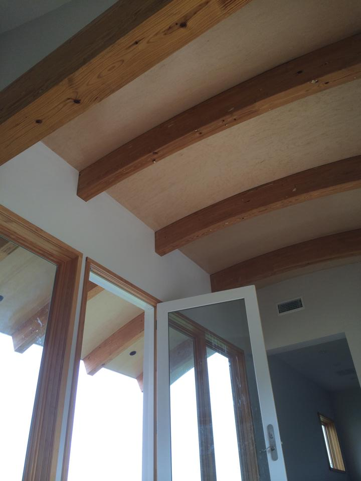 Custom built 10 foot long curved maple ceiling inside and out of front entry.