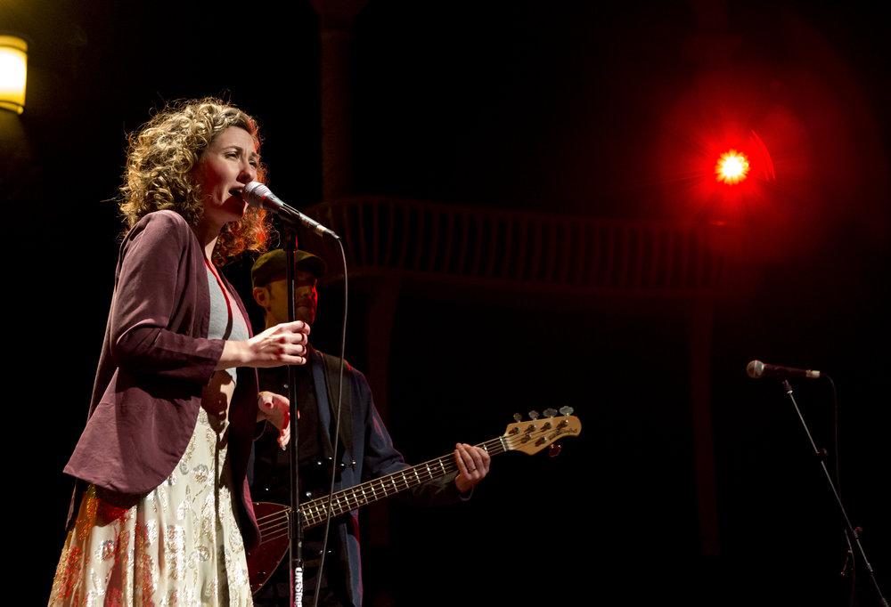 Corinne singing live on stage