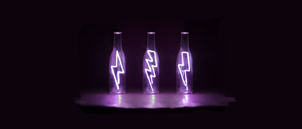 Clear bent glass tubing with argon gas reaction lighting, installed in glass beer bottles. Through the process of creation I had to develop skills in glass manipulation, electrical engineering, soldering and 3-D printing.