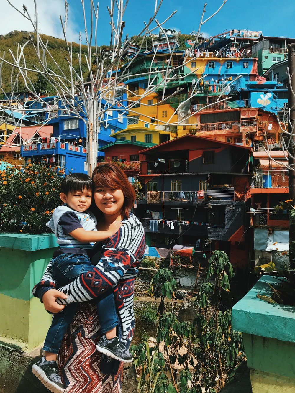 Posing by the mural  with my little boy! - Funny story: We had to do like a 5-minute stop along the road to get this shot because there's really no area for you to park (unless you find a nearby establishment and walk). Mom really wanted a photo so damay nalang kami...