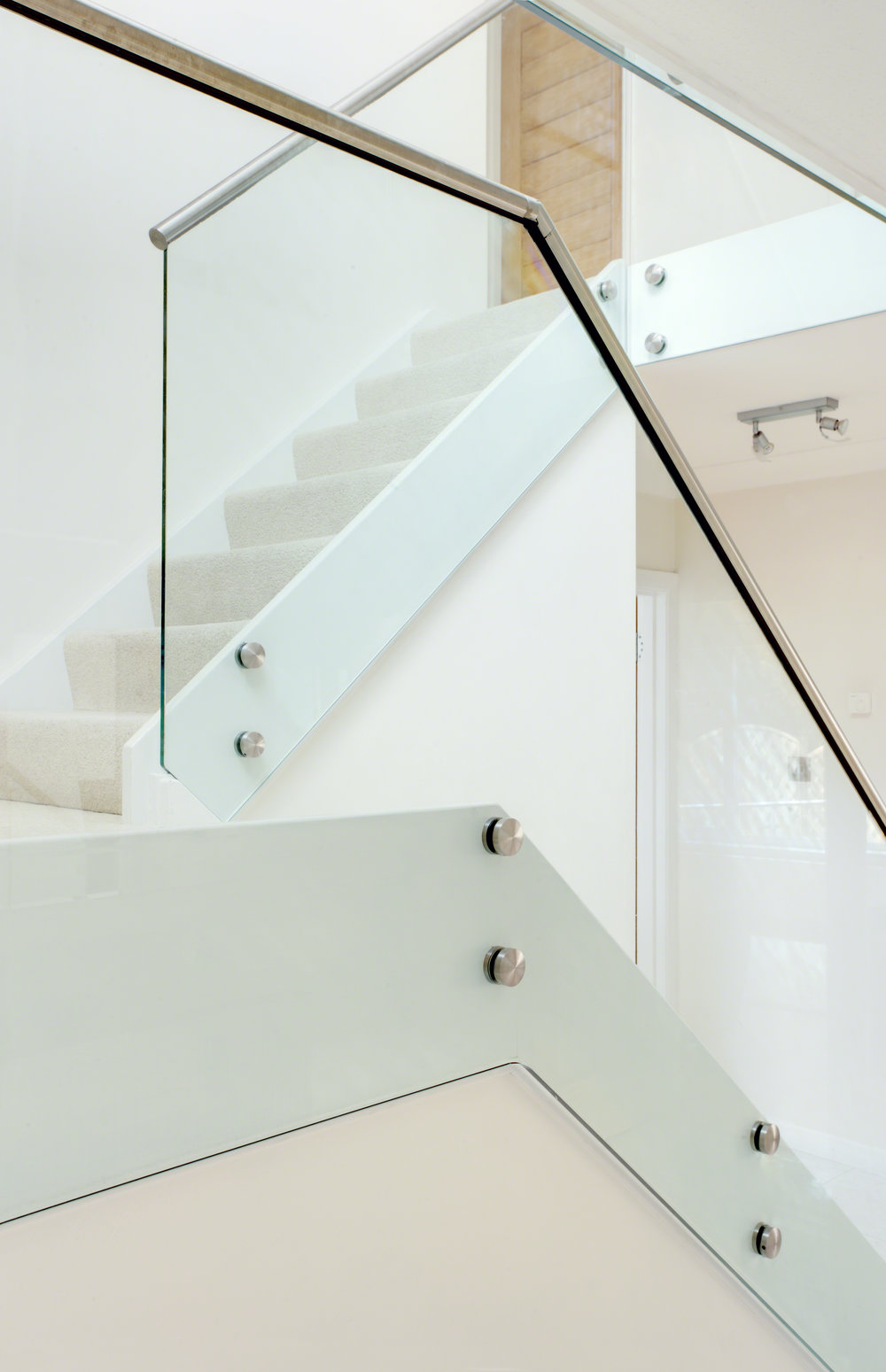Oak Pointe_Cable and Glass Systems_Stainless Steel Handrail with Glass Infill.jpg