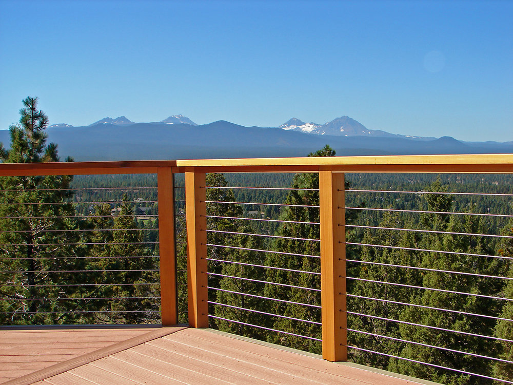 Oak Pointe_Cable and Glass Systems_Wood Newels and Handrail with Cable Infill.jpg