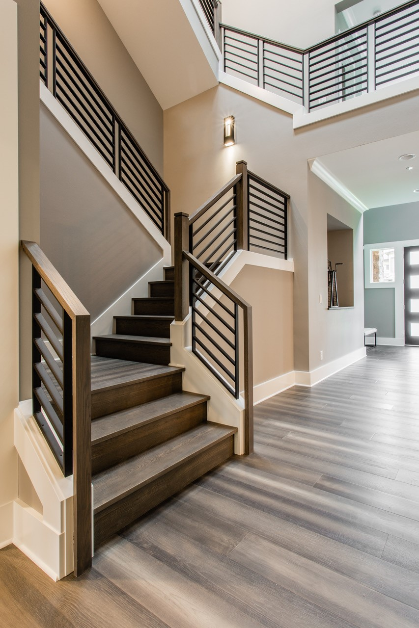 Oak Pointe_Linear Metal Panels_With Wood Handrail.jpg