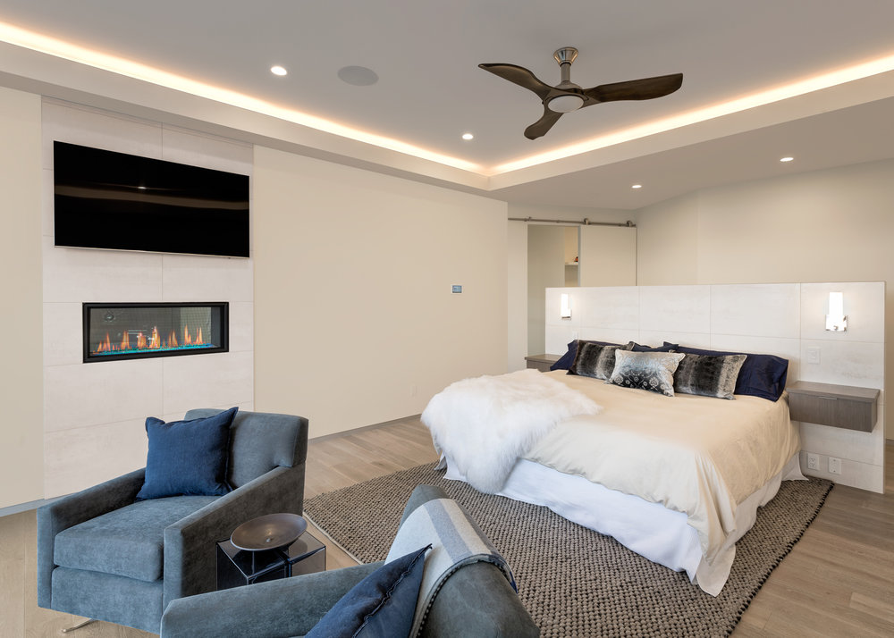 Executive home master bedroom with recessed lighting