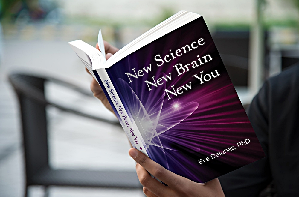 Person reading book entitled New Science, New Brain, New You.