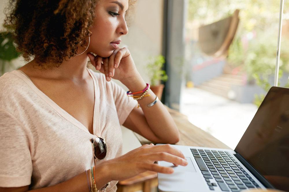 woman at computer taking quiz