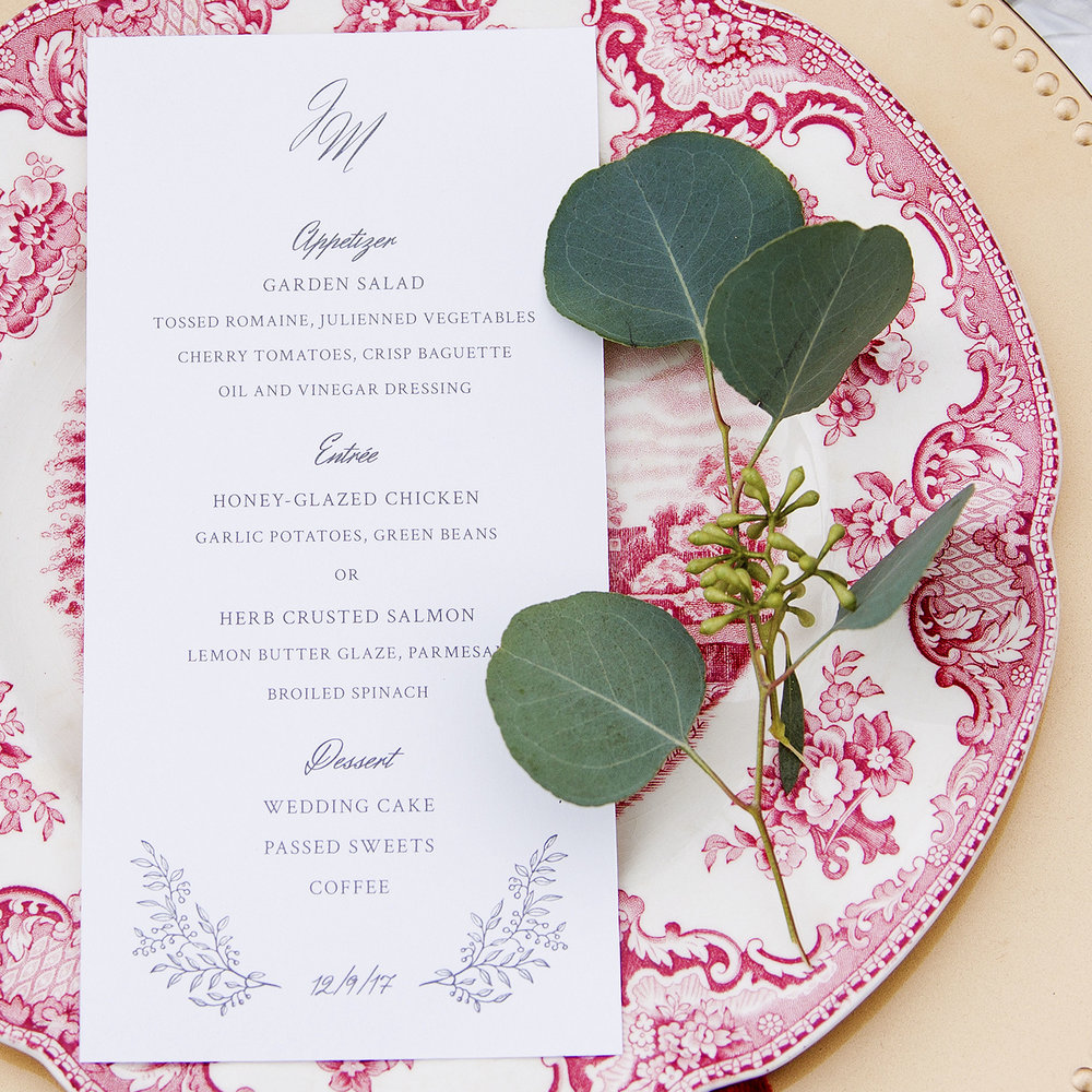 Custom Monogrammed White Classic Floral Charcoal Script Wedding Menu Design on Red China Plate with Flower