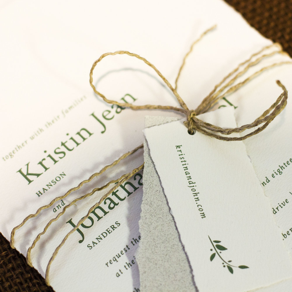 Custom rustic green modern wedding invitation design with deckled edges tied with twine and custom tag