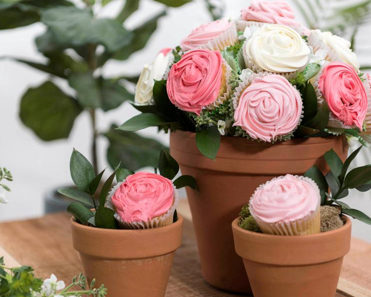#2 Cupcake Bouquet - Make someone's day with a beautiful arrangement of cupcake roses in a terra-cotta pot. It's easier to make than you might think!What you'll need: 16-18 cupcakes, a terra-cotta pot, a foam ball, toothpicks, frosting, piping bags, closed-star piping tips, assorted greenery and extra cupcake liners (optional).