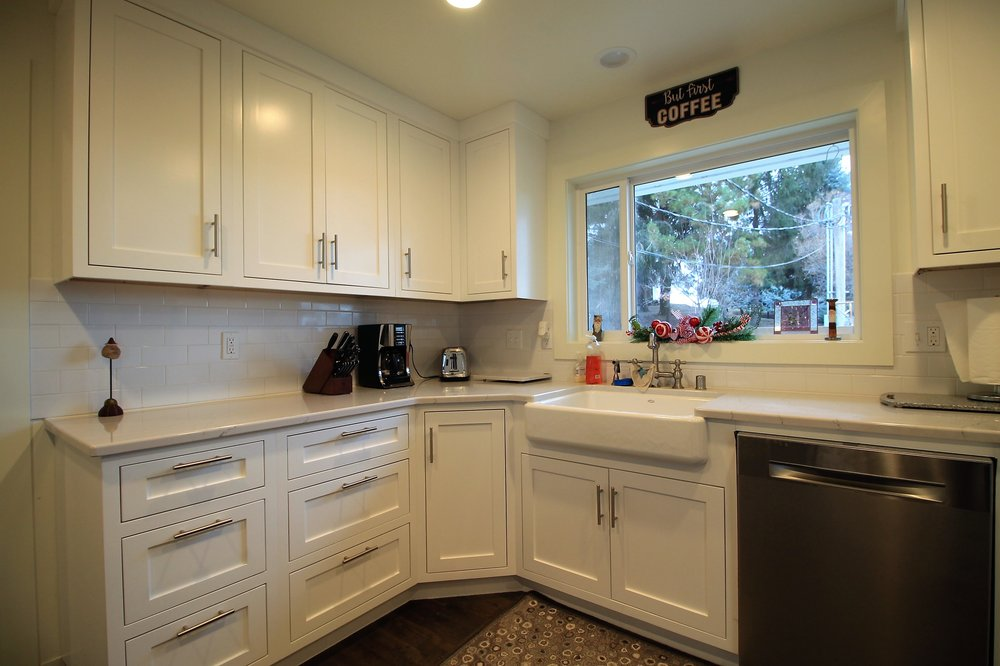 White Painted Cabinets in Updated Farmhouse.