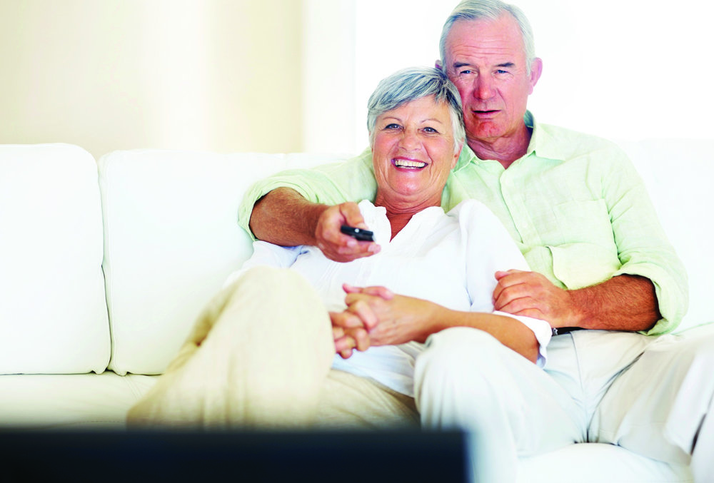 elderly couple watching tv.jpg