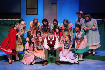 Will Nash Broyles as Tom Tom, Kenny Wade Marshall* as Miss Muffet, and the cast of GVT's 2014 production of  Babes in Toyland . (Photo Courtesy / Greenbrier Valley Theatre) * denotes member of Actors' Equity Association