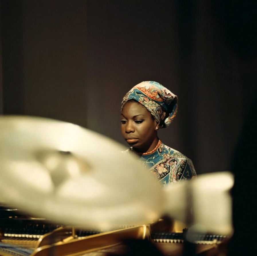 """""""AN ARTIST'S DUTY, AS FAR AS I'M CONCERNED,IS TO REFLECTTHE TIMES."""" - - Nina Simone"""