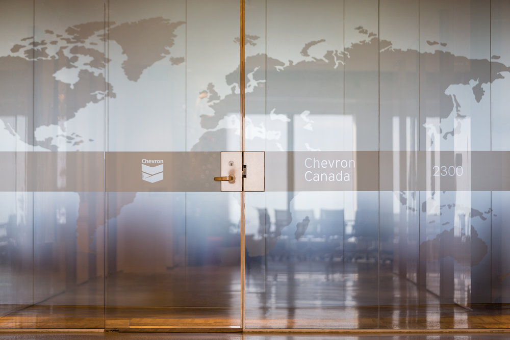 Photo of the office door and ogo placement of Chevron Canada Headquarters in Vancouver