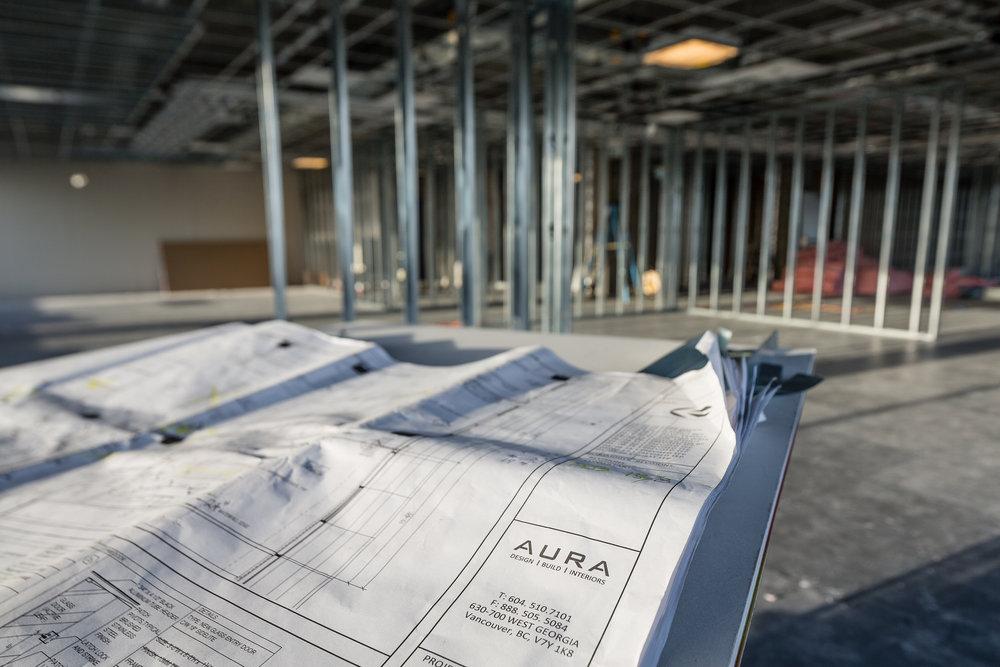 Design plans in a contruction site for interior design company Aura interiors