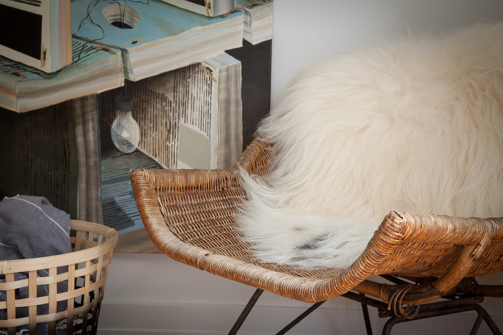 Chair with throw rug and laundry basket interior