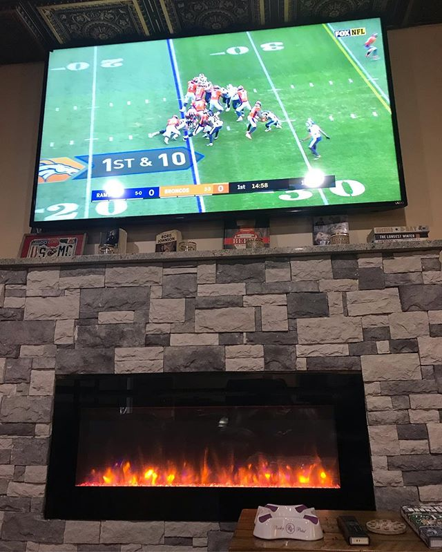 Nothing like enjoying the bronco game by the fireplace on a snowy day at Slo Burn. #sloburncigarsandlounge #broncos