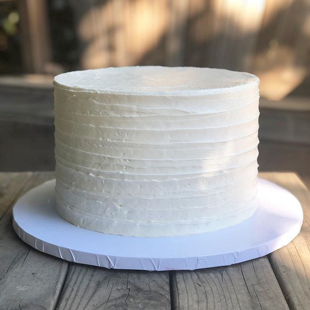 "Yes, I love creating elaborate designs where I get to think outside the box and do something new. But, I also love creating these simple cakes for my awesome clients. (Greenery to be added at the venue) . This cake was for a client who I met at a bridal show in Pasadena several months ago. She planned to only have cupcakes at her wedding, but after tasting my salted caramel white cake wanted a small cake for her and her husband to cut. She had her sister drive THREE hours to pick up this cake because she said ""I have to have this cake at my wedding!"" . I take pride in the quality of my desserts, and this client's testimonial proved it. My desserts taste even better than they look—I dare you to try for yourself. 😉 . #redflourco #saltedcaramelcake #texturedbuttercream #texturedbuttercreamcake #qualitycakes #losangelesweddings #losangeleswedding"