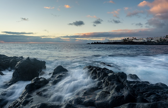 Experimenting with shutter speed on the coast can yield stunning results. Here, the waves crashing over the volcanic coastline of Tenerife complemented the setting sun perfectly. 1/10sec at f/11 and ISO-100 - Tripod mounted.