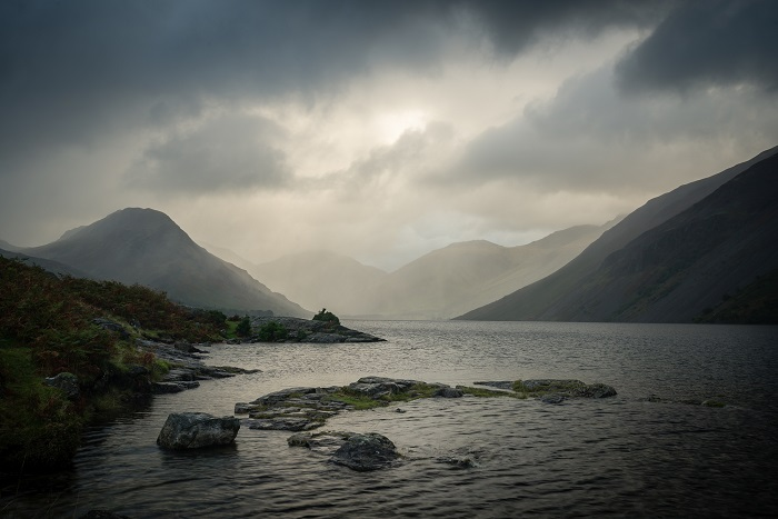 This shot epitomises the need for patience. It required multiple visits to get the water level just right, and then an hour of standing in uninspiring torrential rain by the tripod until the light finally broke through to give the distant mountains that gorgeous glow. In the end patience paid off.