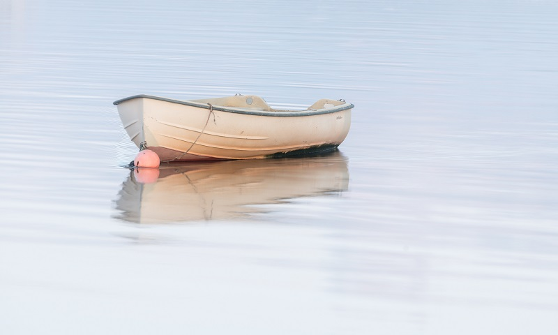 The gentle ripples, soft light, and aesthetically pleasing boat were all the elements I needed to create a gorgeous photograph conveying my emotions precisely.