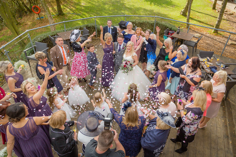 Large groups of wedding guests are best captured from above with a wide angle lens.
