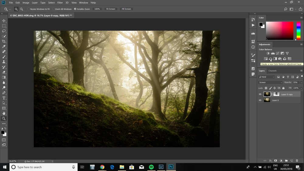 Create a color balance adjustment layer by clicking the button as shown.