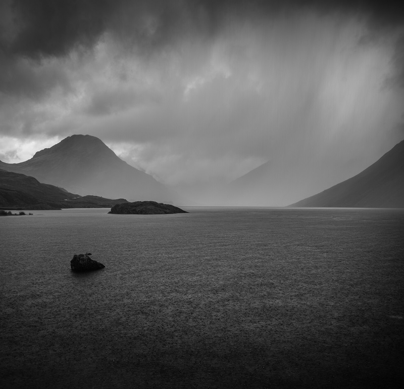 I'm not going to lie to you - I got soaked getting this shot. The squalls of rain were sweeping over where I was stood before reaching the mountains at the end of the lake, but it was worth it to capture the torrential rain bouncing off the water's surface and that dramatic backdrop.
