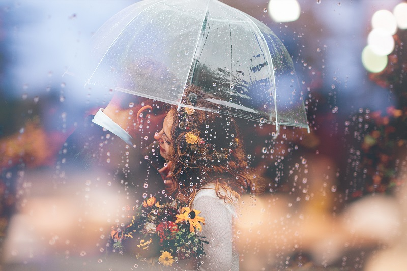 Umbrellas, raindrops, and isolating the happy couple from the rest of the world is the perfect recipe for a great rainy day wedding image.