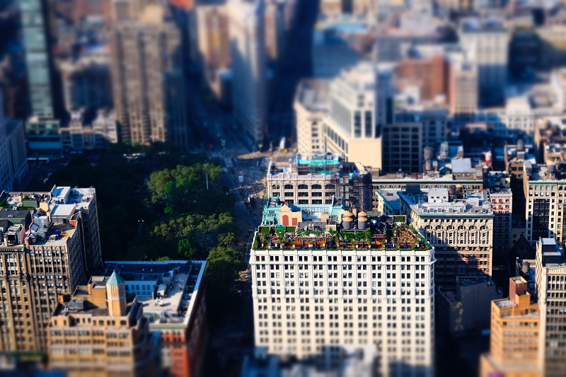 Tilt-shift lenses can be used in creative ways, in this case adjusting the focus plane to make a city scene look miniature.