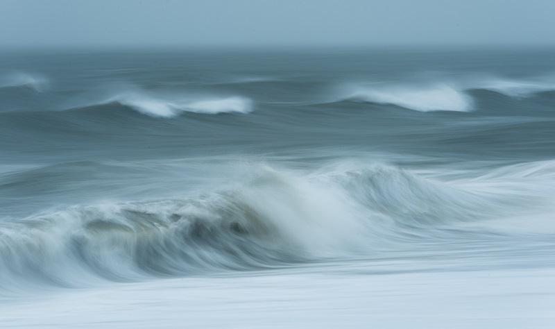 Here, I panned the camera along at the same speed as the wave and used a shutter speed of around one second, enhancing the sense of movement and creating a more abstract take on the incoming tide. This is a mixture of panning and ICM.