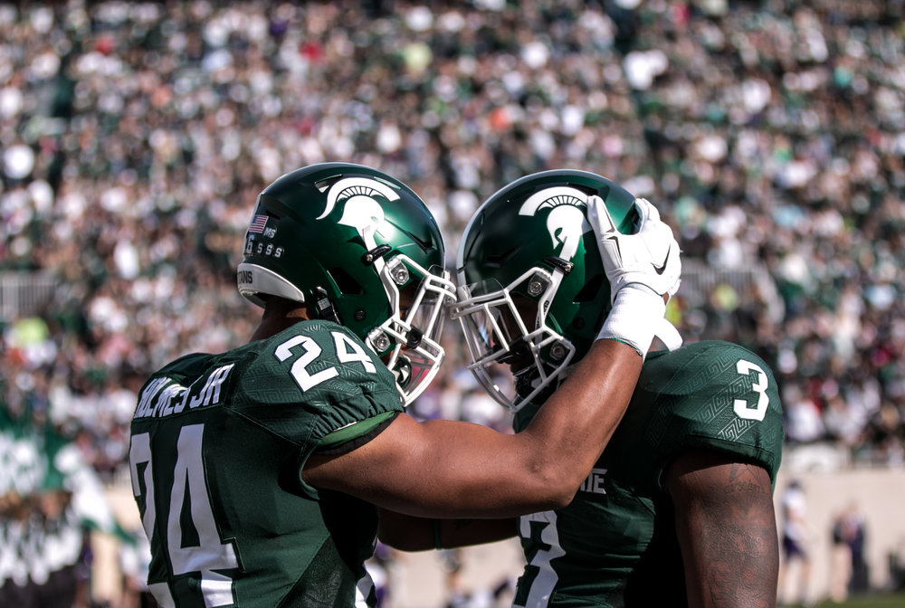 Michigan State running backs Gerald Holmes and LJ Scott share a moment before the first game of the season.