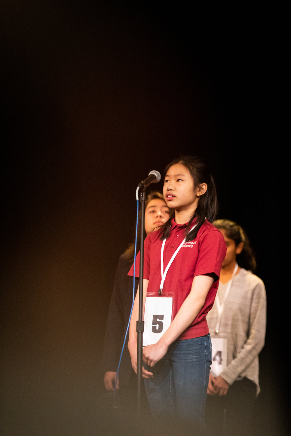 Jenna Ng of New Covenant Schools spells out a word during one of the final rounds of the Lynchburg Regional Spelling Bee on March 9, 2019 at Dunbar Middle School for Innovation.