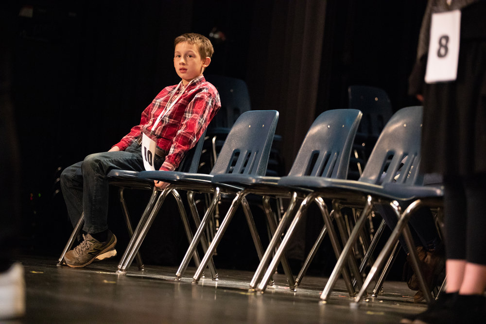 Knox Savill from Appomattox Christian Academy listens intently during a round of the Lynchburg Regional Spelling Bee on March 9, 2019 at Dunbar Middle School for Innovation.