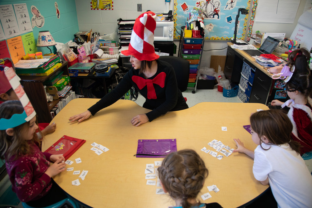 Kindergarten teacher Lindsay Donaruma leads morning activities with her students on Tuesday, Feb. 26, 2019 at Yellow Branch Elementary School. Students are dressed up for Dr. Seuss spirit day for Read Across America week.