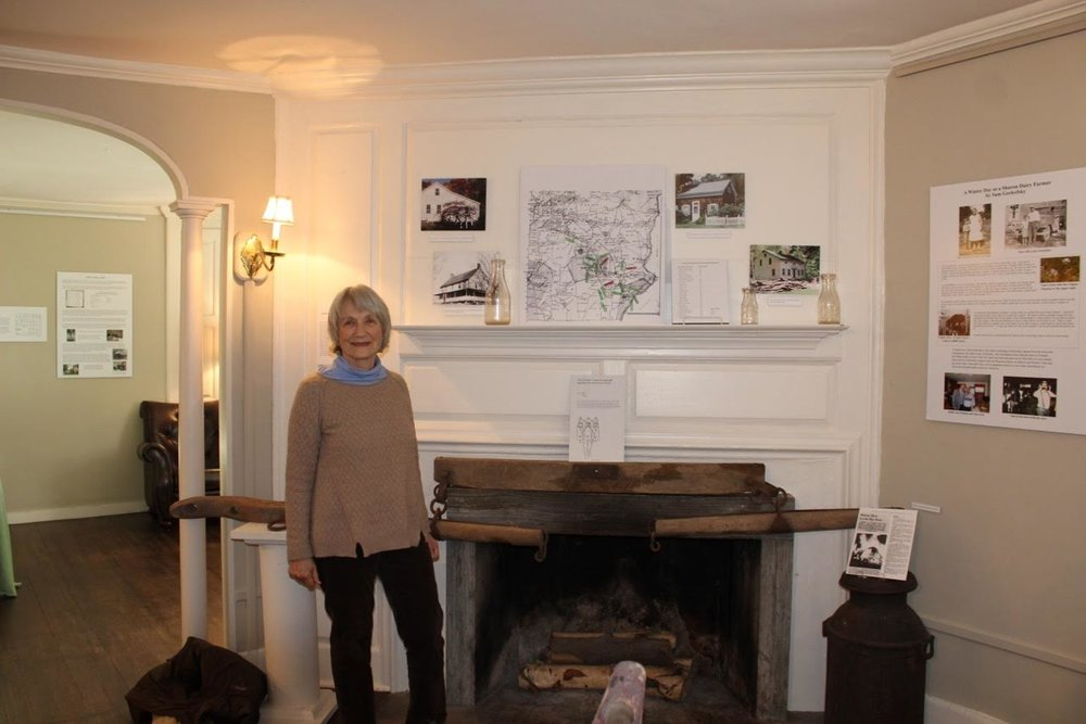 Carol in front of Ellsworth map 2.jpg