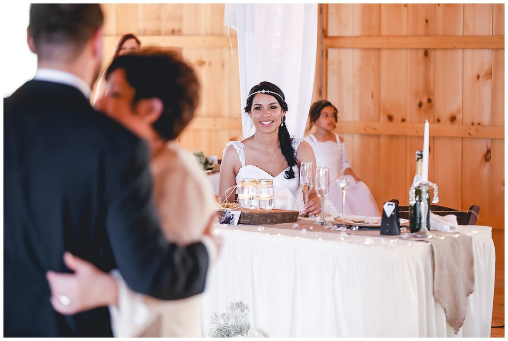bride watches groom and mom dance