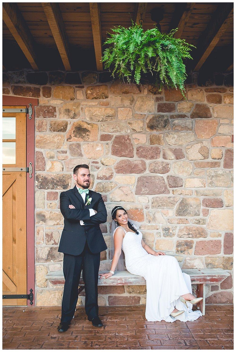 bride and groom portrait outside barn