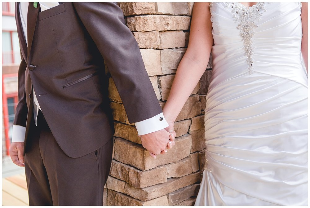 bride and groom hold hands before ceremony