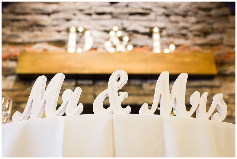 mr. and mrs. sign on table