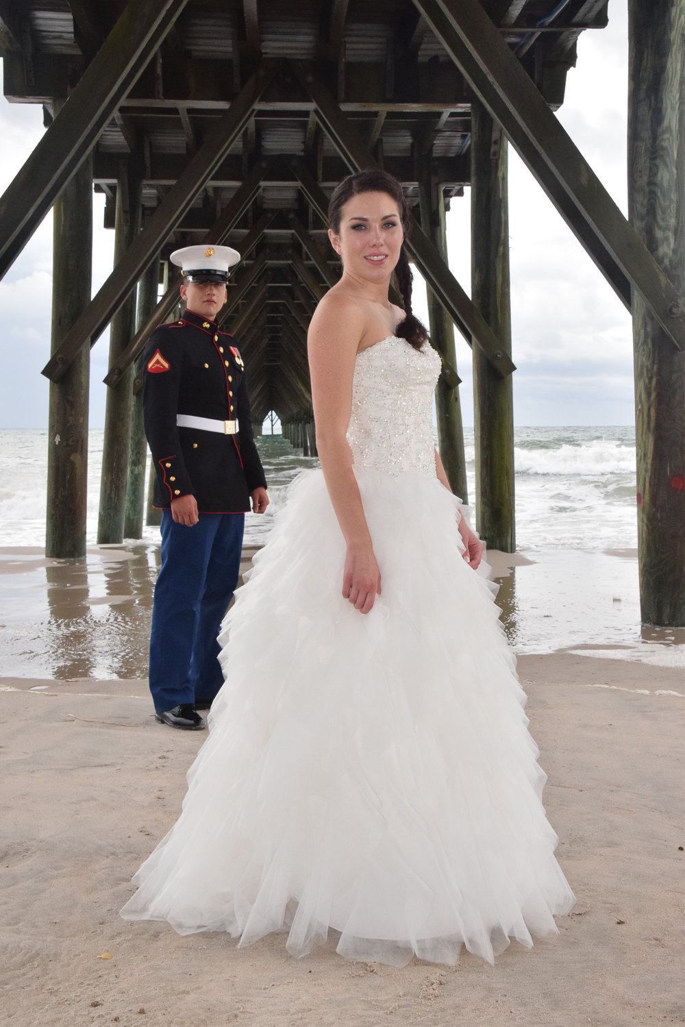 Bride and Groom under pier.